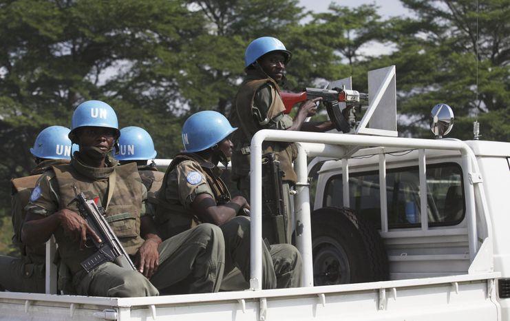 ** FILE ** U.N. forces patrol a street in Abidjan, Ivory Coast, on Thursday, Dec. 23, 2010. (AP Photo/Sunday Alamba)