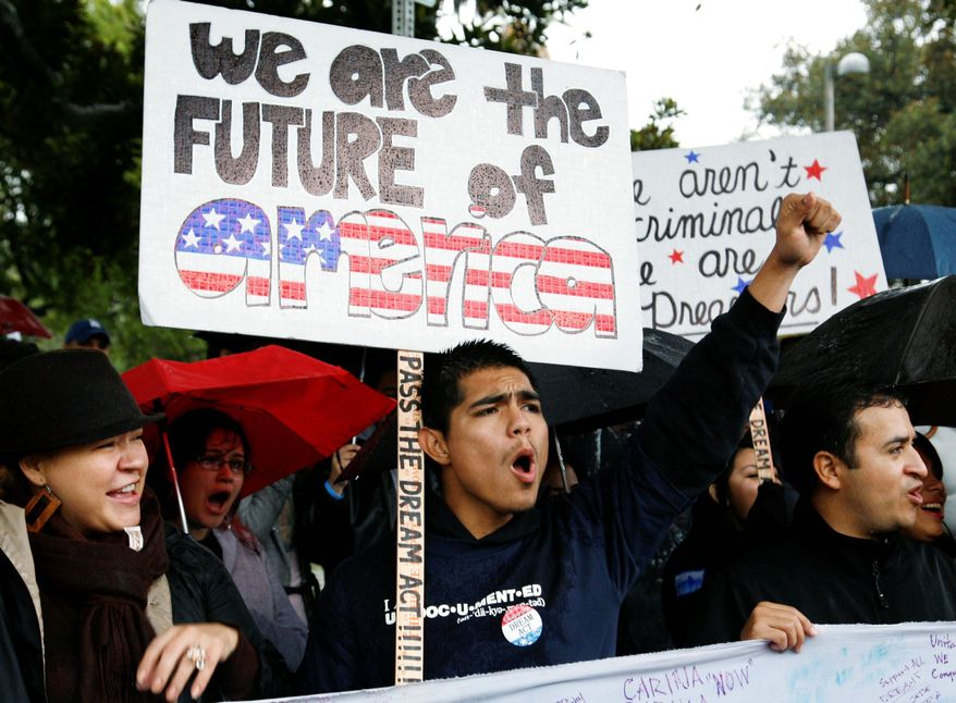 Undocumented college student Jorge Herrera, 18, (center) of Carson, Calif., rallies with students and Dream Act supporters in Los Angeles on Dec. 25, 2010. The Dream Act would have given provisional legal status to illegal immigrants brought to the country as children. (Associated Press)