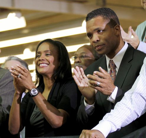 """ASSOCIATED PRESS Rep. Jesse L. Jackson Jr. and his wife, Chicago Alderman Sandi Jackson, applaud as President Obama is introduced at Ford's Chicago assembly plant in August. Mr. Jackson says he's a """"public servant"""" not a """"perfect servant."""" He says he's been dogged by links to disgraced former Gov. Rod R. Blagojevich."""