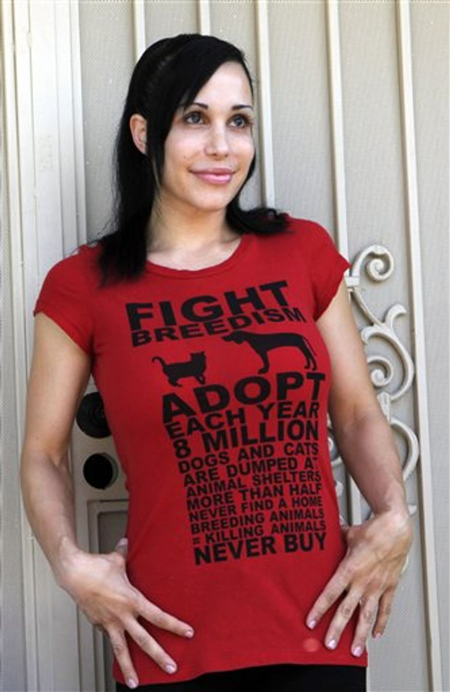 FILE - In this March 11, 2009 file photo, Nadya Suleman, the mother of octuplets, leaves her home in Whittier, Calif. Suleman may be able to avoid eviction from her Southern California home for at least a month. The co-founder of adult film company Vivid Entertainment has offered to pay her February mortgage while he considers whether to buy the La Habra home. (AP Photo/Nick Ut, File)