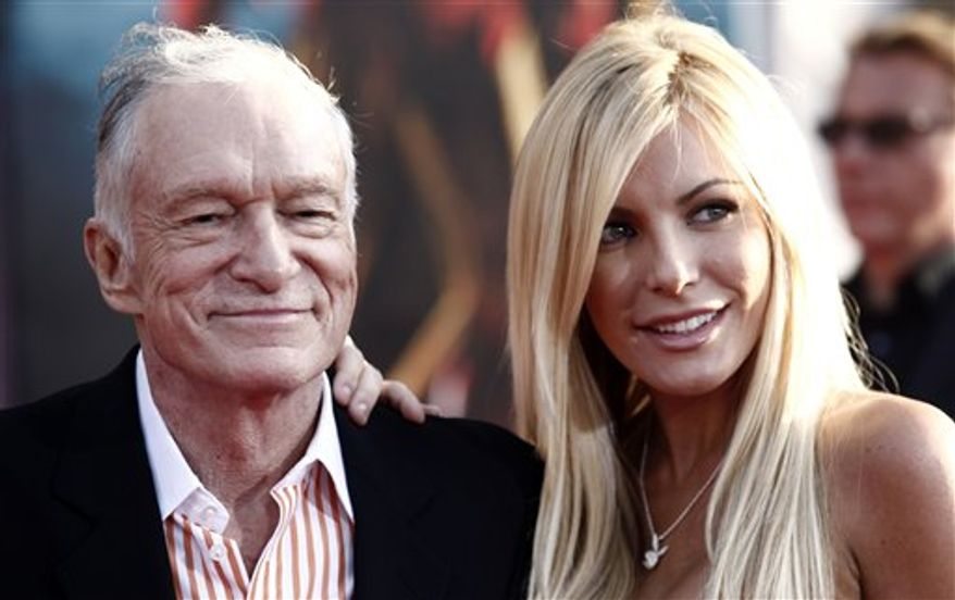 "FILE - Hugh Hefner, left, and Crystal Harris arrives at the premiere of ""Iron Man 2"" at the El Capitan Theatre in Los Angeles in this April 26, 2010 file photo. Hefner says he's gotten engaged again. Hefner said in a Twitter message early Saturday Dec. 24, 2010 that he'd given a ring to girlfriend and Playmate Crystal Harris, saying she burst into tears. (AP Photo/Matt Sayles, File)"