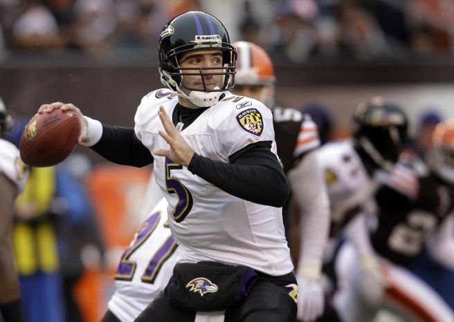 Baltimore Ravens quarterback Joe Flacco (5) looks to throw against the Cleveland Browns during first-quarter NFL football game action on Sunday, Dec. 26, 2010, in Cleveland. (AP Photo/Tony Dejak)