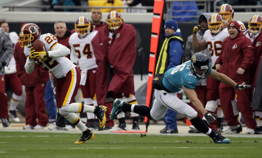 Washington Redskins cornerback Carlos Rogers (22) intercepts a pass intended for Jacksonville Jaguars tight end Zach Miller (86) during the first half of an NFL football game in Jacksonville, Fla., Sunday, Dec. 26, 2010.(AP Photo/John Raoux)