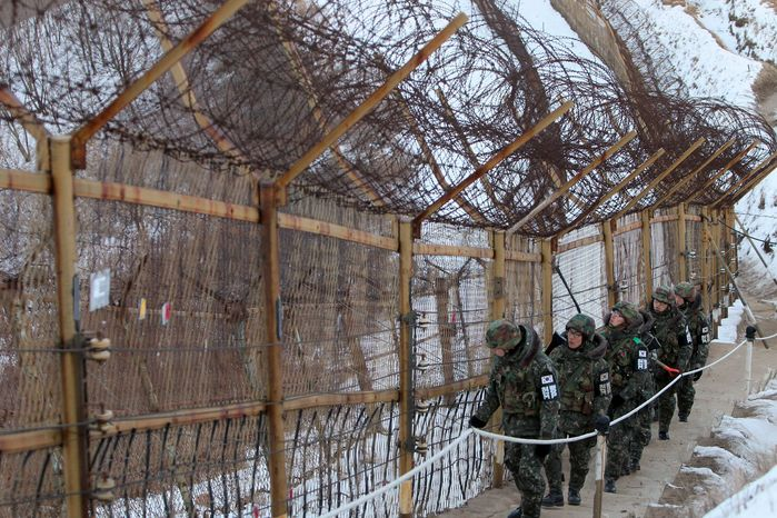 South Korean soldiers check on the front line of the demilitarized zone (DMZ) that has separated the two Koreas since the Korean War, in Inje, South Korea, north of Seoul, on Friday, Dec. 24, 2010. (AP Photo/ Lee Sang-hak, Yonhap)