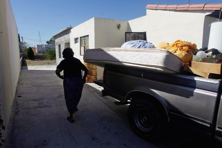 A woman who asks not to be identified packs the last of her last belongings into a pickup truck in mid-November as she prepares to abandon her Ciudad Mier home because of the violence.