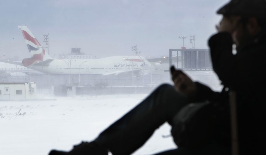Kevin Fagan of San Francisco talks on his phone at John F. Kennedy International Airport in New York on Monday, Dec. 27, 2010. Mr. Fagan was trying to get to Berlin, Germany, when the blizzard hit and he was forced to sleep in the airport. (AP Photo/Seth Wenig)
