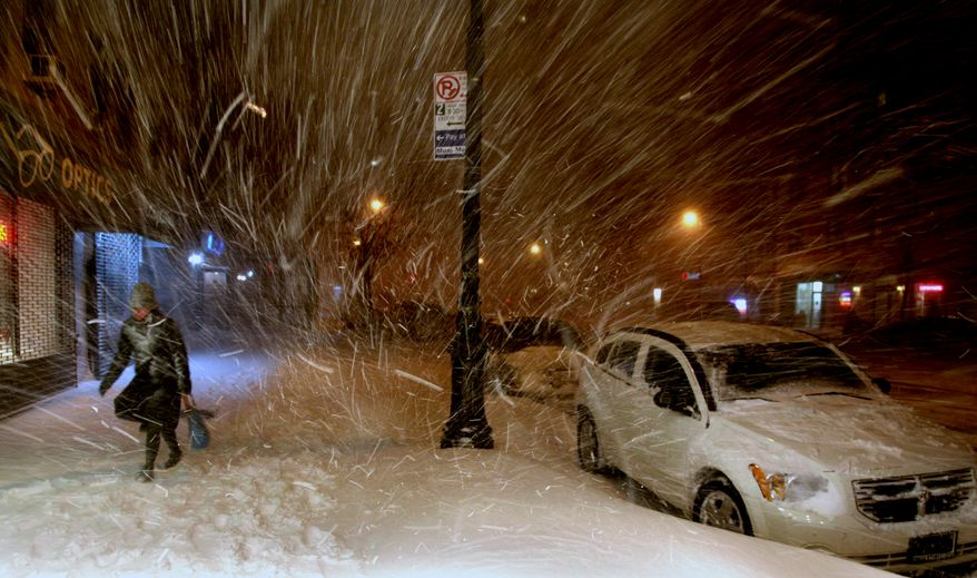 A woman walks along 72nd Street in New York on Sunday, Dec. 26, 2010, in the midst of a blizzard that hammered New York and much of the Northeast. (AP Photo/Craig Ruttle)