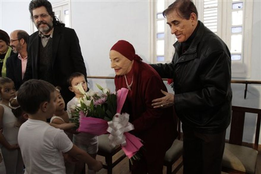 Cuba's Prima Ballerina Alicia Alonso arrives at the headquarters of Cuba's National Ballet to receive the 2010 National Award of Education in Arts in Havana, Cuba, Monday, Dec. 27, 2010. (AP Photo/Franklin Reyes)