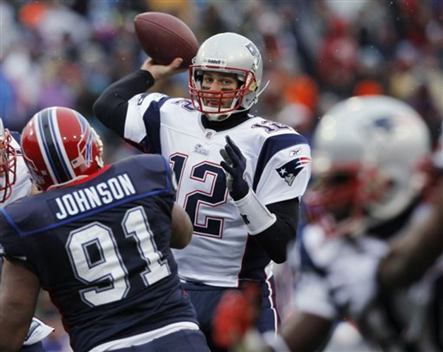 New England Patriots quarterback Tom Brady attempts a pass against the Buffalo Bills during the second half of an NFL football game in Orchard Park, N.Y., on Sunday, Dec. 26, 2010. New England won 34-3. Brady set an NFL record for pass attempts without an interception on the play. (AP Photo/Don Heupel)