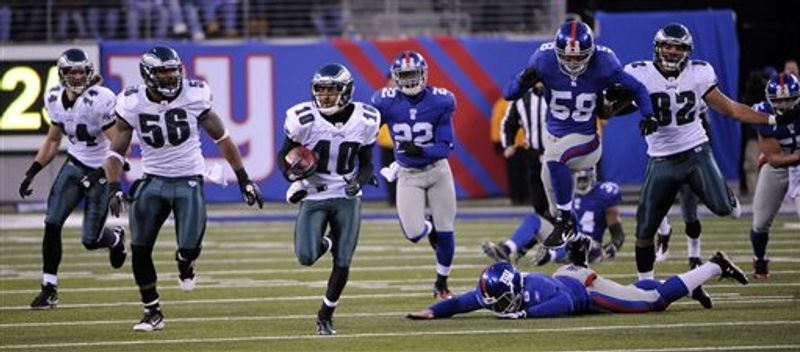 FILE - In this Dec. 19, 2010, file photo, Philadelphia Eagles' DeSean Jackson (10) returns a punt for a touchdown during the fourth quarter of the NFL football game between the Philadelphia Eagles and the New York Giants at New Meadowlands Stadium in East Rutherford, N.J. Chasing on the play are New York Giants punter Matt Dodge (6), Gerris Wilkinson (58) and Brian Jackson (22). It was the NFL's first game-winning punt return on the final play from scrimmag.  (AP Photo/Bill Kostroun, File)