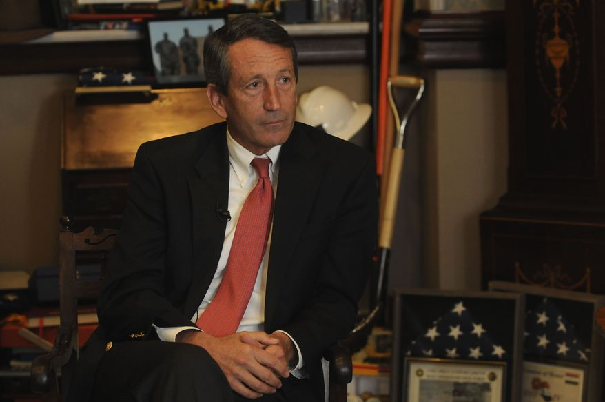 South Carolina Gov. Mark Sanford talks with Associated Press reporters on Tuesday, Dec. 14, 2010, in his office in Columbia, S.C. Mr. Sanford reflected on his time in office and spoke about his future. (AP Photo/Virginia Postic)