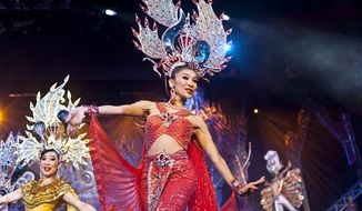 FILE - In this Oct. 31, 2009 file photo, performers appear on stage at the Miss International Queen 2009 transvestite beauty pageant in Pattaya, Thailand. Thailand's National Film Board has rejected a movie about a transgender father struggling to raise two children, a ban that the director says highlights the conservative side of Thai society despite its freewheeling reputation. (AP Photo/David Longstreath, FILE)