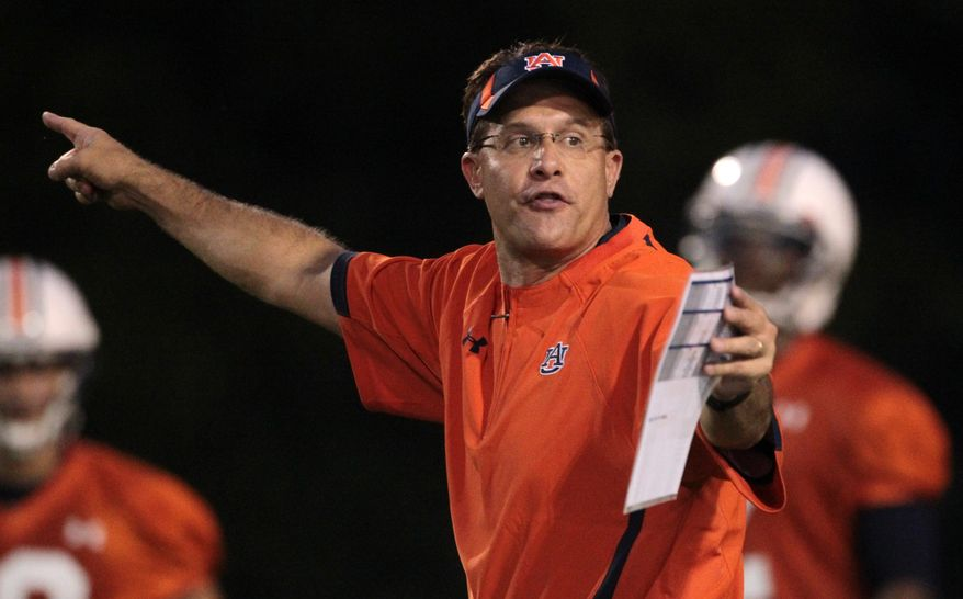 """FILE - This is an Aug. 2, 2010 file photo shows Auburn offensive coordinator Gus Malzahn directing his players on the opening day of practice in Auburn, Ala. Malzahn says he is waiting for the """"right time, right place"""" to become a head coach. Vanderbilt apparently wasn't that place. Malzahn would not talk about the Vanderbilt head coaching position in an interview Wednesday, Dec. 15, 2010 but said that he does want to run his own program """"somewhere down the line."""" (AP Photo/Dave Martin, File)"""