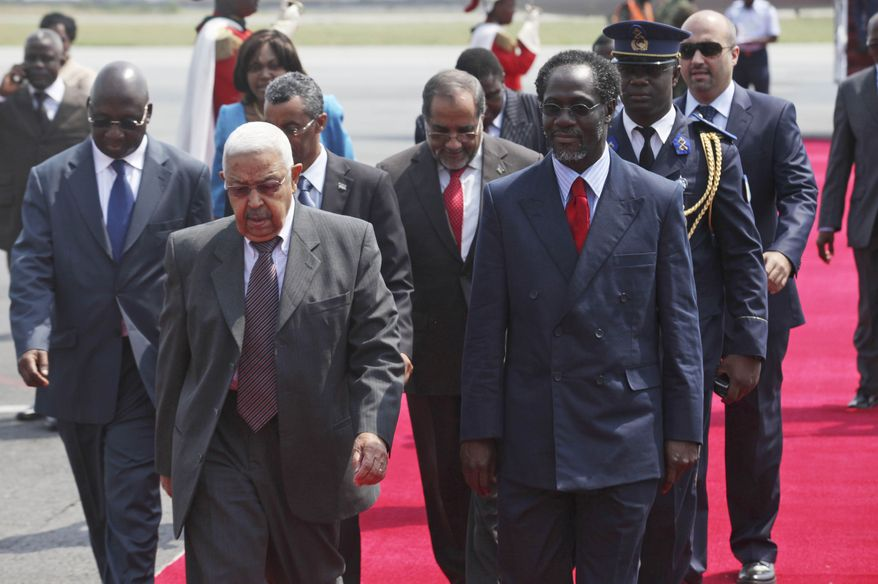 Cape Verde President Pedro Pires (front left) walks with Ivory Coast Prime Minister Ake N'gbo on Mr. Pires' arrival at the airport in Abidjan, Ivory Coast, on Tuesday, Dec. 28, 2010. Mr. Pires was part of a delegation of West African leaders who went to Ivory Coast to confront Laurent Gbagbo and demand that he step down from the presidency or face a possible regional military intervention. (AP Photo/Sunday Alamba)