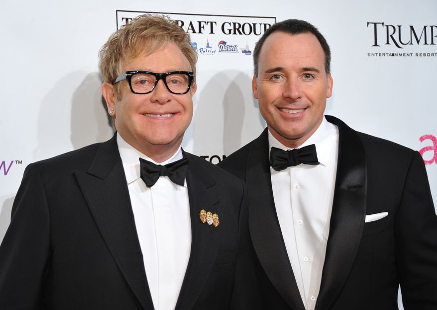 "** FILE ** Sir Elton John (left) and husband David Furnish attend the ninth annual Elton John AIDS Foundation benefit ""An Enduring Vision"" at Cipriani Wall Street in New York in October 2010. Mr. John and Mr. Furnish have become parents to a 7-pound, 15-ounce baby boy born on Christmas Day. (AP Photo/Evan Agostini, File)"