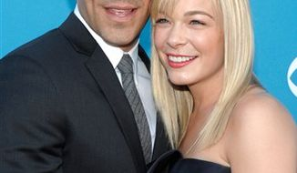 "FILE - In this April 18, 2010 file photo, LeAnn Rimes and Eddie Cibrian arrive at the 45th Annual Academy of Country Music Awards in Las Vegas.  Rimes' publicist, Rhett Usry, confirmed Tuesday, Dec. 28, 2010 that the country singer and the actor ""were engaged over the holidays and are very happy."" (AP Photo/Dan Steinberg, File)"