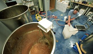 Owner Ben Starr mixes up a batch of mead at his company, Starrlight Mead, in Pittsboro, N.C. Mead, the drink of medieval verse, is making a comeback. But it isn't just the honey wine of tales. There are fruit-flavored meads, called melomels, and there are methyglyns made with spices. (Associated Press)