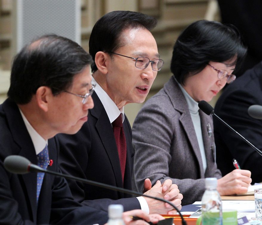 South Korean President Lee Myung-bak (center) delivers a speech Wednesday on next year's foreign-policy plans in Seoul. South Korea's president is calling for urgency in dismantling neighboring North Korea's atomic weapons program. (Yonhap news agency via Associated Press)