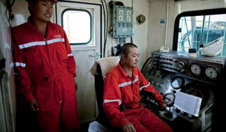 Chinese technicians man drilling equipment on an oil rig in Paloich. China's interest here is high. Six government officials from the south's oil producing region flew to China earlier in the fall, and analysts say China is trying to improve ties with the south and maintain them with the north. (Associated Press)