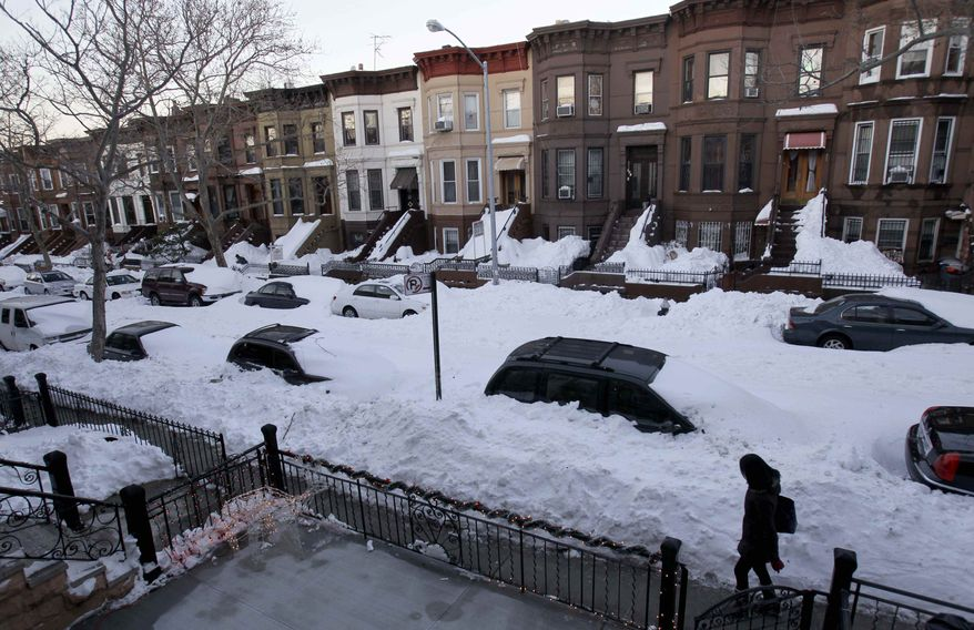 While most residents had cleared sidewalks of snow, many streets remained unplowed in the Sunset Park section of New York's Brooklyn borough on Tuesday, Dec. 28, 2010. (AP Photo/Seth Wenig)