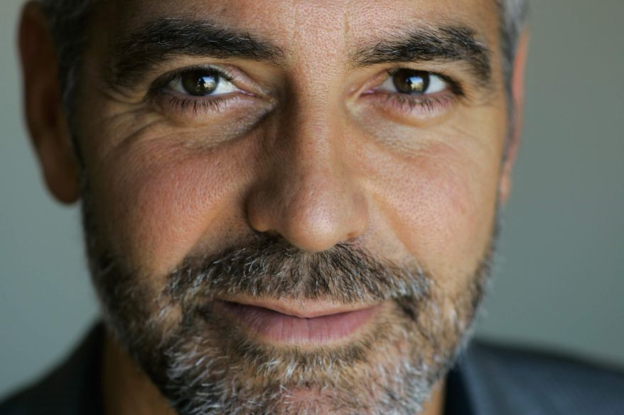 ** FILE ** George Clooney poses for a portrait during the Toronto International Film Festival in Toronto in 2007. A group founded by American actor George Clooney said on Tuesday, Dec. 28, 2010, it has teamed up with Google, a U.N. agency and anti-genocide organizations to launch satellite surveillance of the border between north and south Sudan to try to prevent a new civil war after the south votes in a secession referendum next month. (AP Photo/Carolyn Kaster, File)