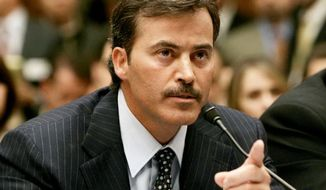 **FILE** Rafael Palmeiro testifies during a hearing on Capitol Hill to examine the use of steroids in professional baseball on March 17, 2005. (Associated Press)