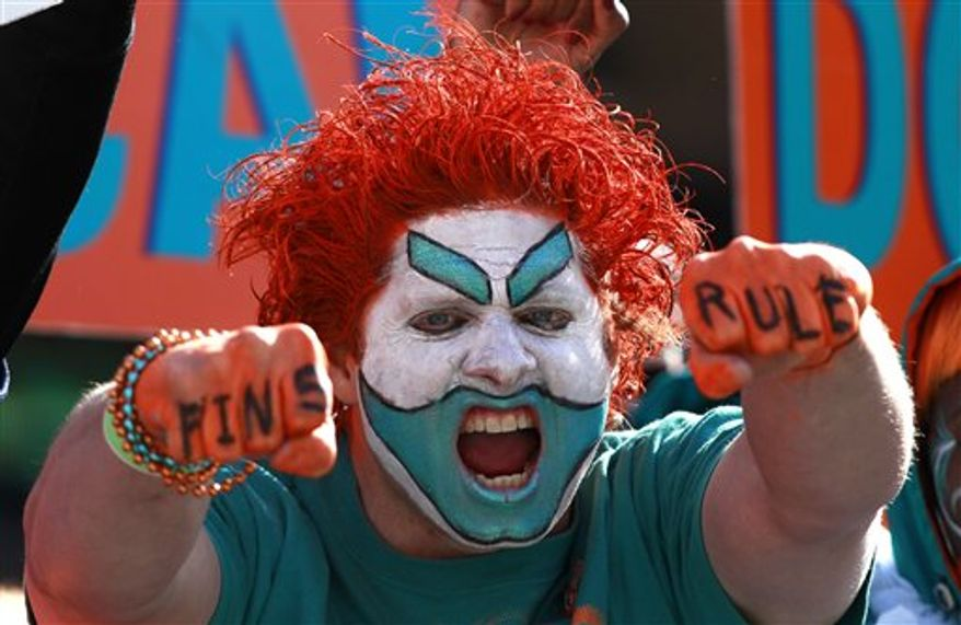 A Miami Dolphins fan yells during an NFL football game against the Detroit Lions in Miami, Sunday, Dec. 26, 2010. (AP Photo/Hans Deryk)