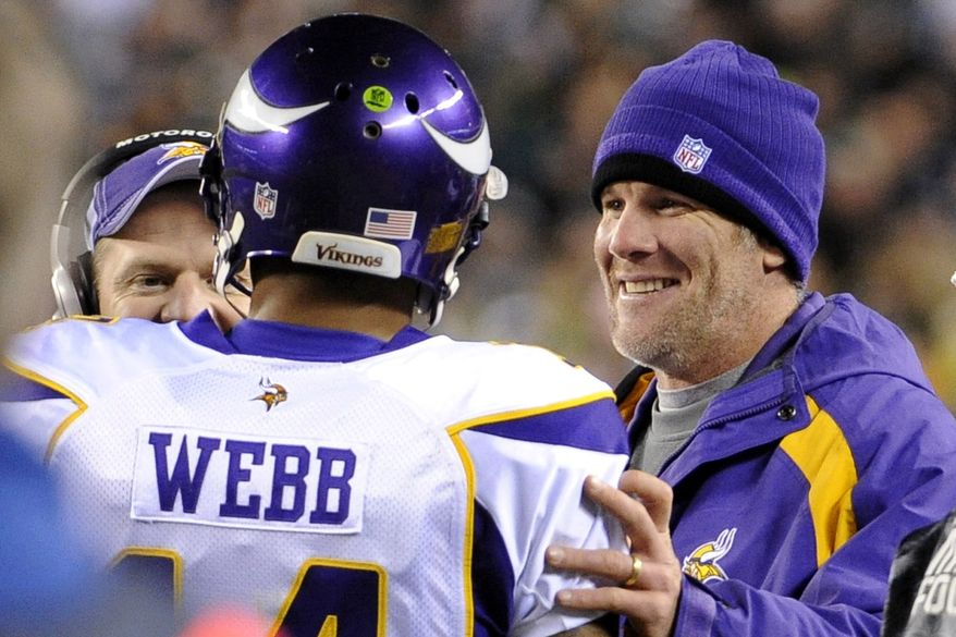 Minnesota Vikings injured quarterback Brett Favre, right, congratulates quarterback Joe Webb after Webb's touchdown run in the second half of an NFL football game against the Philadelphia Eagles on Tuesday, Dec. 28, 2010, in Philadelphia. (AP Photo/Miles Kennedy)