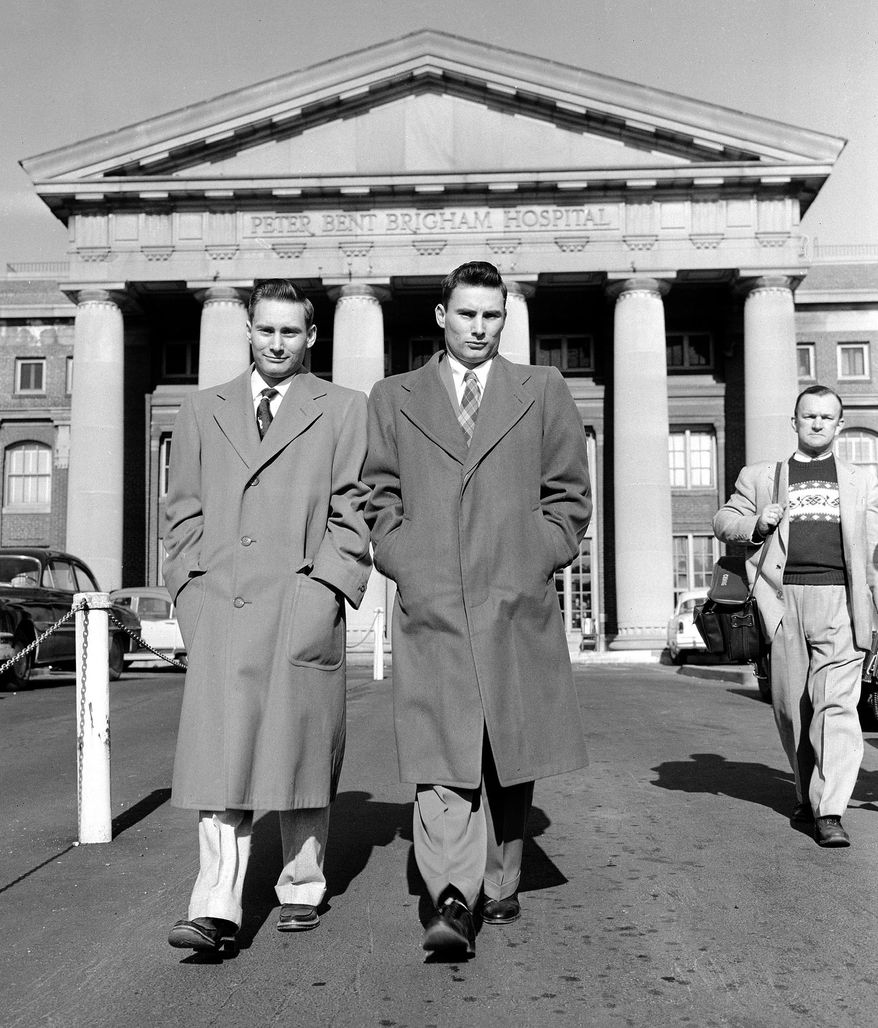 Richard Herrick, left, and his twin brother, Ronald, leave Peter Bent Brigham Hospital, later known as Brigham and Women's Hospital, in Boston, on Jan. 30, 1955, after fully recovering from a Dec. 23, 1954, kidney transplant that was recognized as the world's first successful organ transplant. Richard lived eight years after receiving the transplant. Ronald, who donated the kidney, died Monday, Dec. 27, 2010, in Augusta, Maine. He was 79. (AP Photo/File)