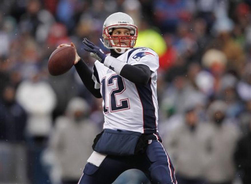 In this Sunday, Dec. 26, 2010, photo, New England Patriots quarterback Tom Brady passes against the Buffalo Bills during an NFL football game in Orchard Park, N.Y. Brady's 11th NFL season has to rank among his best as he guided the Patriots to another AFC East title and homefield advantage through the playoffs. (AP Photo/Mike Groll)