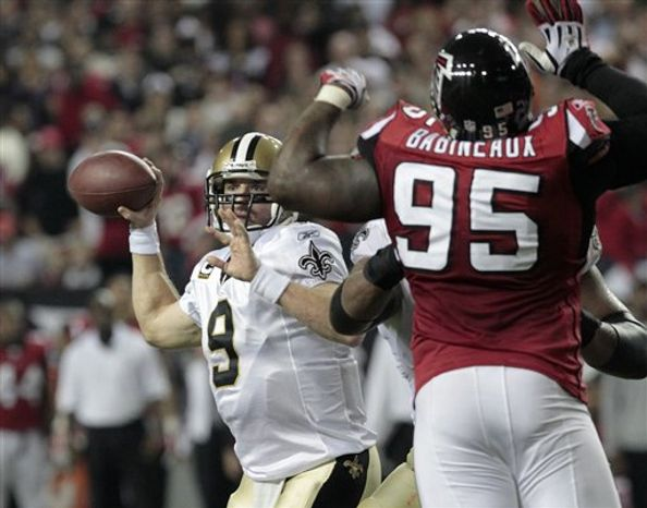 Atlanta Falcons quarterback Matt Ryan (2) is sacked by New Orleans Saints defender Jimmy Wilkerson (99) in the second half of their NFL football game at the Georgia Dome in Atlanta Monday, Dec. 27, 2010. (AP Photo/David Goldman)