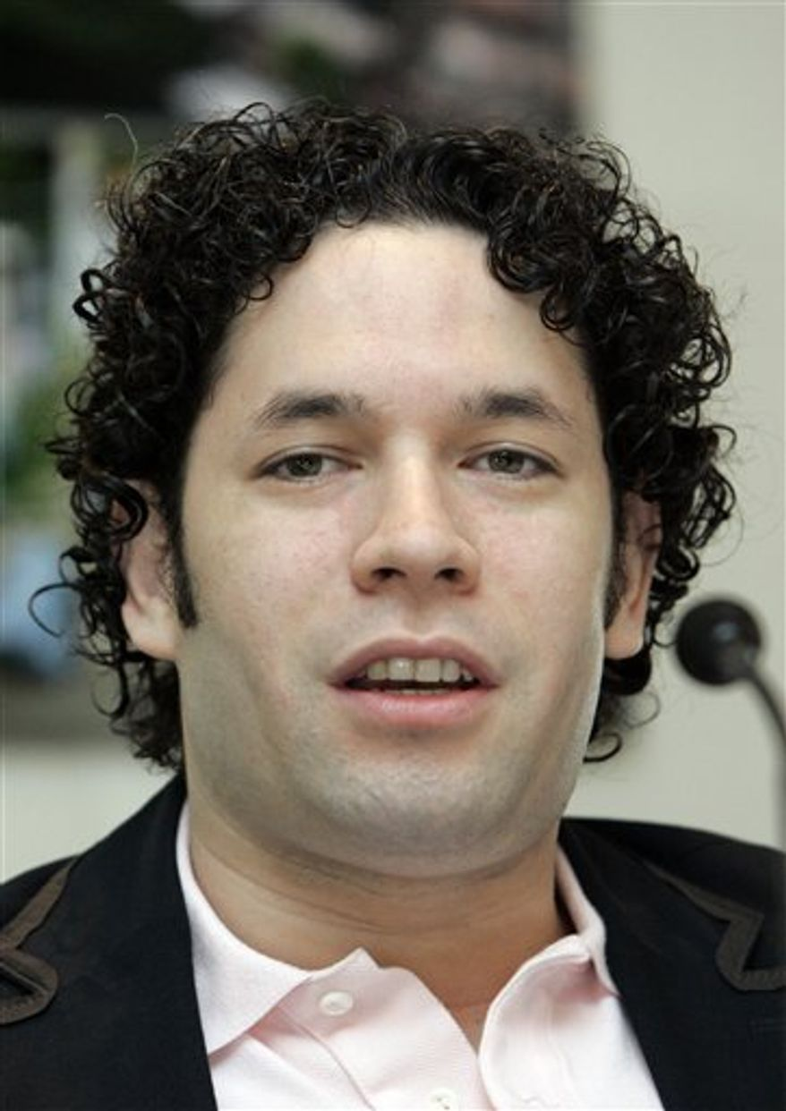 """FILE - In this Oct. 14, 2009 file photo, conductor Gustavo Dudamel speaks at a news conference in Vienna, Austria. Dudamel's passion for music education is on display in a new PBS special """"Gustavo Dudamel: Conducting a Life,"""" airing Wednesday Dec. 28, 2010. (AP Photo/Lilli Strauss, file)"""