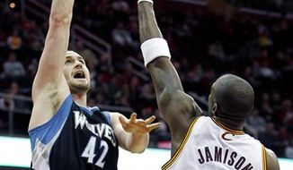 Minnesota Timberwolves' Kevin Love (42) shoots over Cleveland Cavaliers' Antawn Jamison (4) in the first quarter of an NBA basketball game Sunday, Dec. 26, 2010, in Cleveland. The Timberwolves won 98-97. (AP Photo/Ron Schwane)