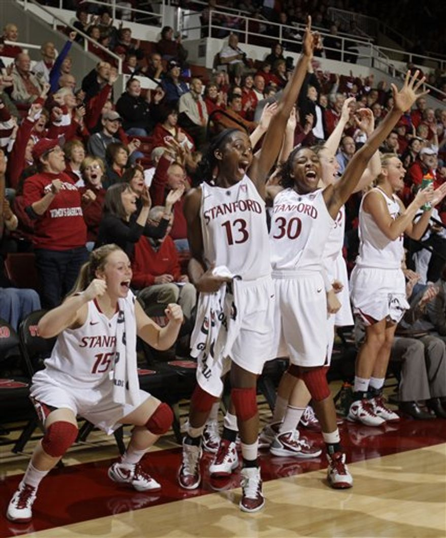 Stanford guard Jeanette Pohlen (23) scores in front of Xavier guard Megan Askew (23) in the second half of an NCAA college basketball game in Stanford, Calif., Tuesday, Dec. 28, 2010. Stanford defeated Xavier 89-52. (AP Photo/Paul Sakuma)