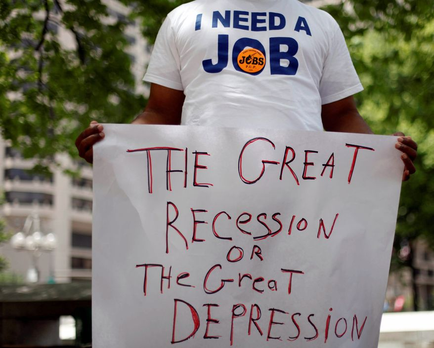 Frank Wallace, unemployed since May of 2009, holds a sign during a rally in June organized by the Philadelphia Unemployment Project. (Associated Press)