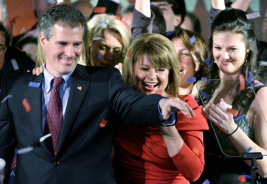 Massachusetts Republican Sen.-elect Scott Brown with wife Gail celebrates in January after his upset victory in the special election to replace deceased Democratic Sen. Edward M. Kennedy. (Associated Press)