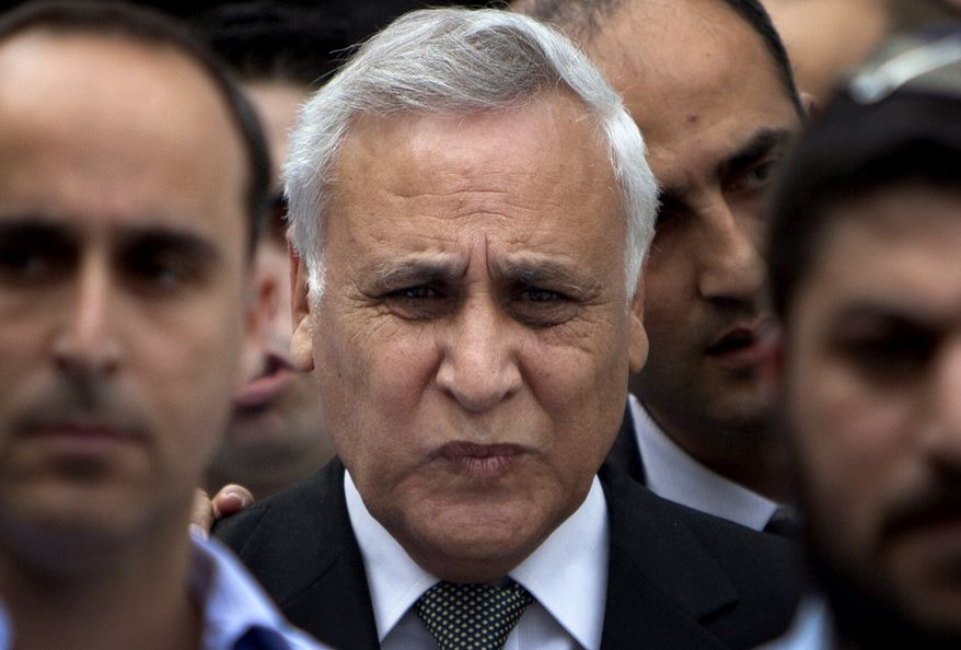 Former Israeli President Moshe Katsav (center) leaves a court in Tel Aviv Thursday after being convicted of two charges of raping an employee when he was a Cabinet minister. They are the most serious criminal charges ever brought against a high-ranking Israeli official. (Associated Press)