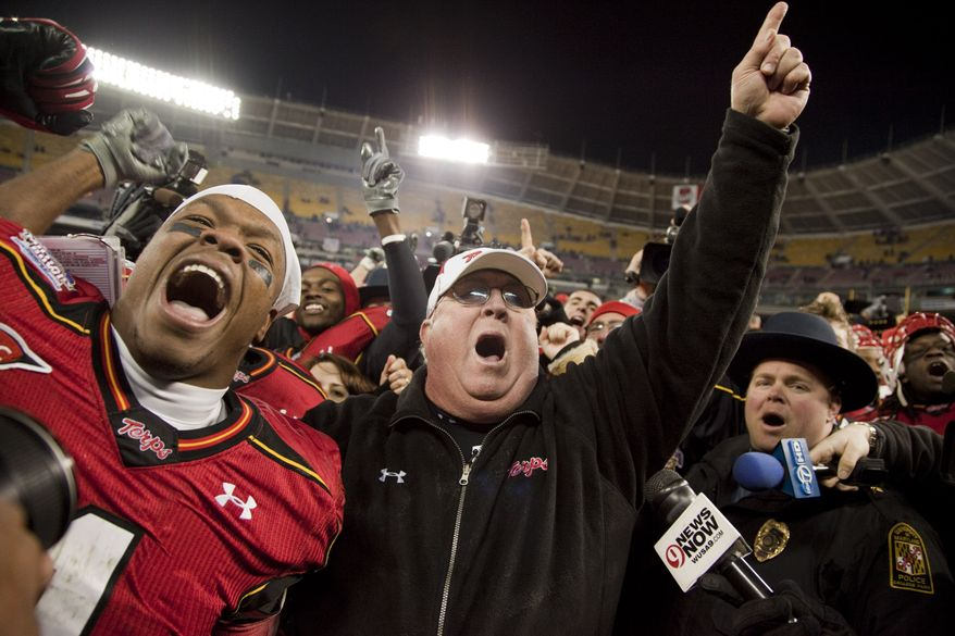 Maryland head coach Ralph Friedgen celebrates with his players after Maryland's 51-20 win over East Carolina in the Military Bowl on Wednesday in Washington. (Associated Press)