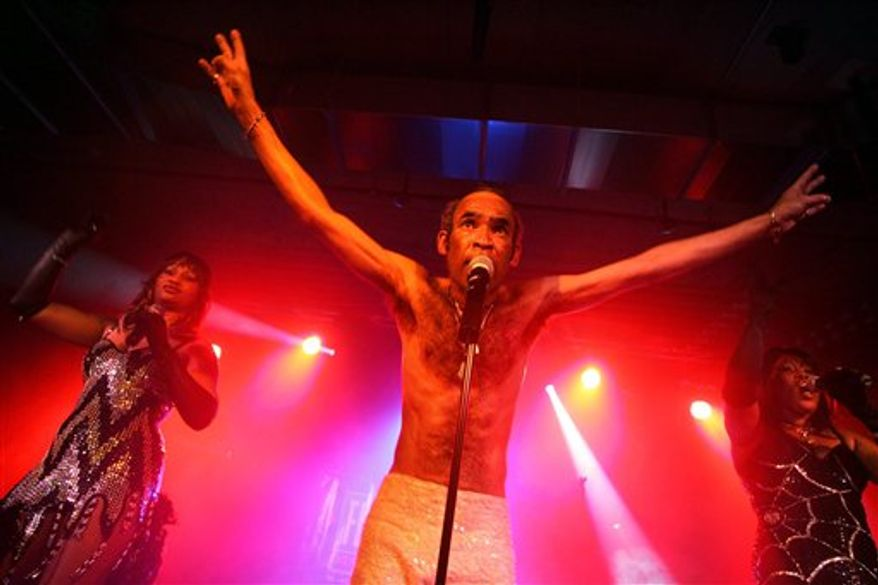 FILE - This Saturday May 14, 2005 file photo shows Bobby Farrell of the group  Boney M performing  in a hall at Kloten airport in Zurich, Switzerland. Performer Bobby Farrell, of the 1970's European chart-topping group Boney M, was found dead in his hotel bed Thursday Dec. 30, 2010, while on tour in Russia, his agent said. He was 61.Farrell appeared as scheduled in St. Petersburg Wednesday night, but complained of breathing problems before and after his show, said the agent, John Seine. He had been due to fly to Rome Thursday for a television show. (AP Photo/Keystone, Alessandro Della Bella)