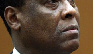 ** FILE ** Dr. Conrad Murray appears at a procedural hearing in Los Angeles in April 2010. (AP Photo/David McNew, Pool, File)