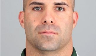 FILE - In this May 20, 2010, file photo, Sal Alosi, of the New York Jets football team, poses for a photographer. The NFL fined the Jets $100,000 on Thursday, Dec. 30, 2010, for violating league rules when assistant coach Alosi tripped Miami Dolphins' Nolan Carroll on the sideline during a punt return earlier this month. (AP Photo/File)
