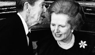 ** FILE ** President Ronald Reagan has a word in the ear of British Prime Minister Margaret Thatcher at a reception given by the British government at London's St. James's Palace for leaders attending an economic conference in 1984. (AP Photo, File)