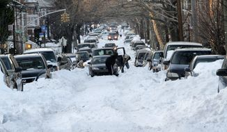 Cars are stuck on unplowed 56th Street in the Borough Park neighborhood of New York's Brooklyn borough on Wednesday, Dec. 29, 2010. (AP Photo/Mary Altaffer)