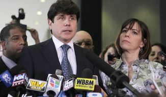 ** FILE ** Former Illinois Gov. Rod Blagojevich, with his wife, Patti, talks to members of the media in Chicago on Aug. 17, 2010, after a federal jury found him guilty of one count of lying to FBI agents. (AP Photo/Kiichiro Sato, File)