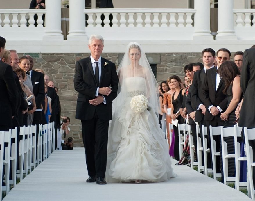 Former President Bill Clinton walks his daughter Chelsea down the isle for her wedding in Rhinebeck, N.Y on July 31, 2010. (AP Photo/Genevieve de Manio Photography,Genevieve de Manio, File)