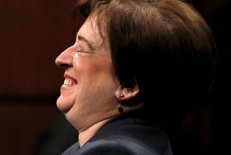 Supreme Court nominee Elena Kagan laughs on Capitol Hill in Washington on June 29, 2010, while testifying before the Senate Judiciary Committee hearing on her nomination. (AP Photo/Alex Brandon, File)