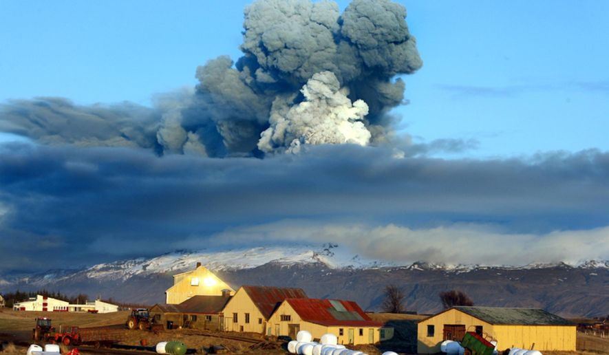 The volcano in southern Iceland's Eyjafjallajokull glacier sends ash into the air just before sunset on April 16, 2010. (AP Photo/Brynjar Gauti) ** FILE **