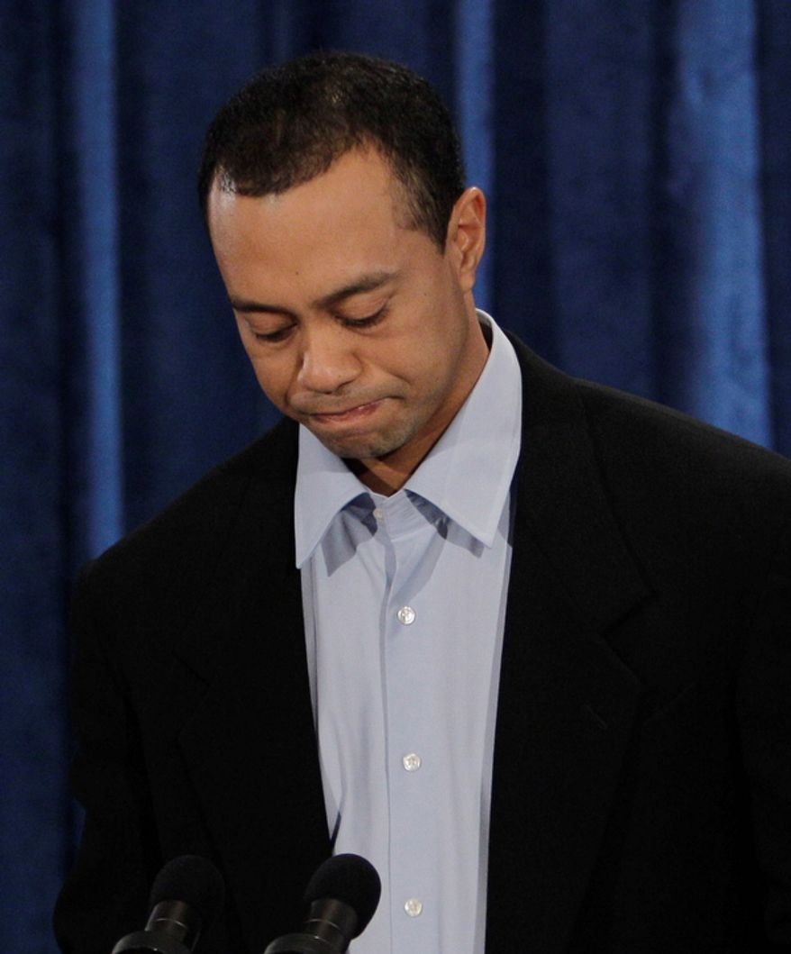 Tiger Woods pauses during a news conference, in Ponte Vedra Beach, Fla on Feb. 19, 2010. (AP Photo/Eric Gay, File)