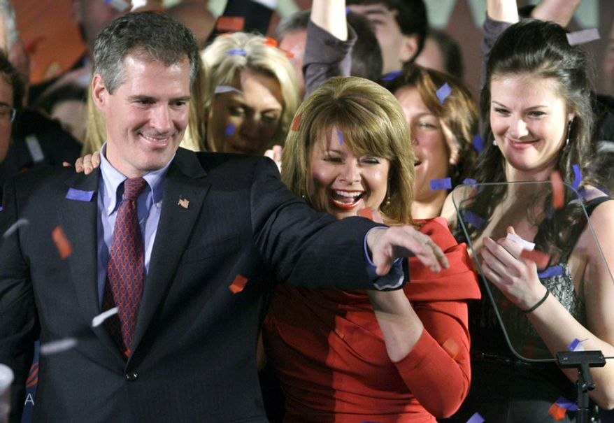 Massachusetts State Sen. Scott Brown, R-Wrentham, celebrates in Boston with wife Gail, center, and daughter Ayla, right, after winning a special election held to fill the U.S. Senate seat left vacant by the death of Sen. Edward Kennedy Tuesday, Jan. 19, 2010.    (AP Photo/Charles Krupa, File)