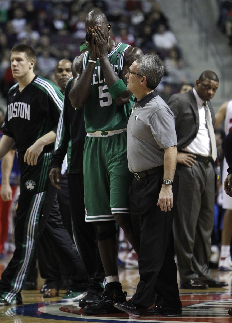 Boston Celtics forward Kevin Garnett (5) reacts after suffering an injury Wednesday during the first quarter against the Detroit Pistons in Auburn Hills, Mich. (Associated Press)